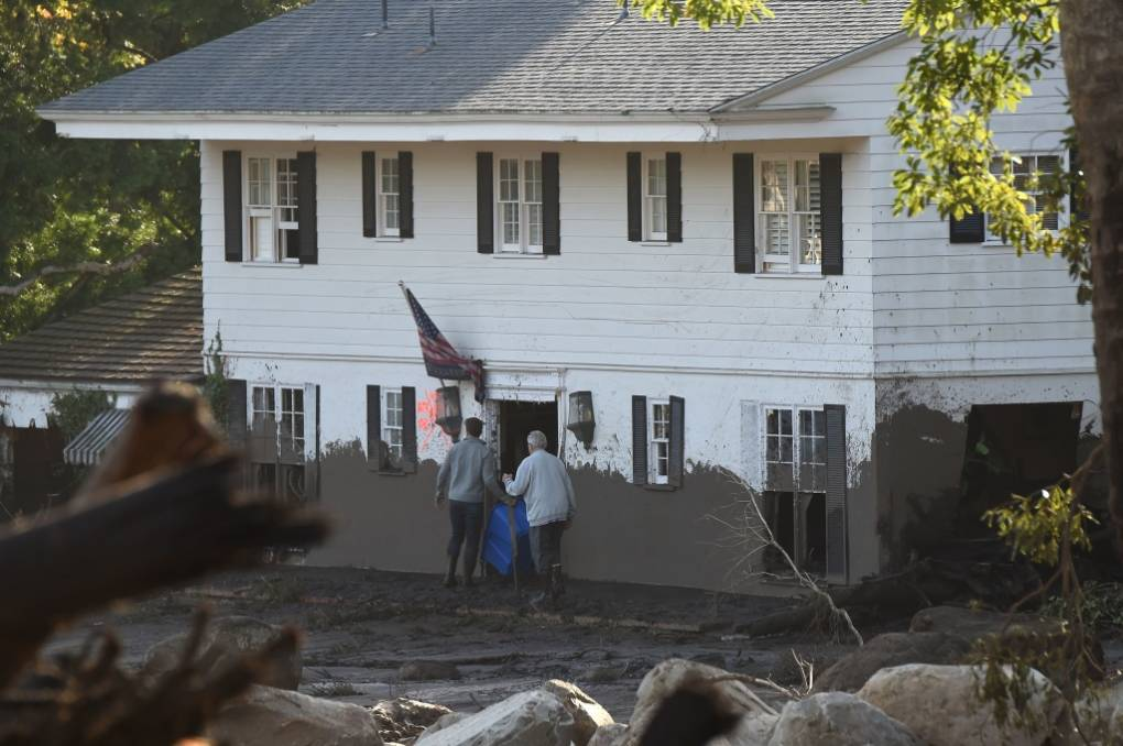 Residents return to their home to retrieve belongings after a massive mudflow in Montecito, California, January 10, 2018.