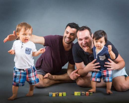 Elad and Andrew Dvash-Banks pose for photos with their twin sons, Ethan and Aiden. Ethan is a plaintiff in a federal lawsuit against the State Department that seeks the same rights as his brother, who is a U.S. citizen.