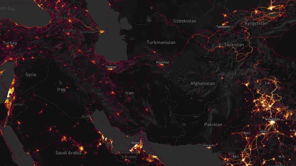 Zooming in on countries with few native Strava users is one way to track likely NATO forces, experts say. Known bases in Afghanistan and Syria appeared with bright lines amid dark backgrounds in the exercise tracking firm's map. Strava Heat Map; Screenshot by NPR