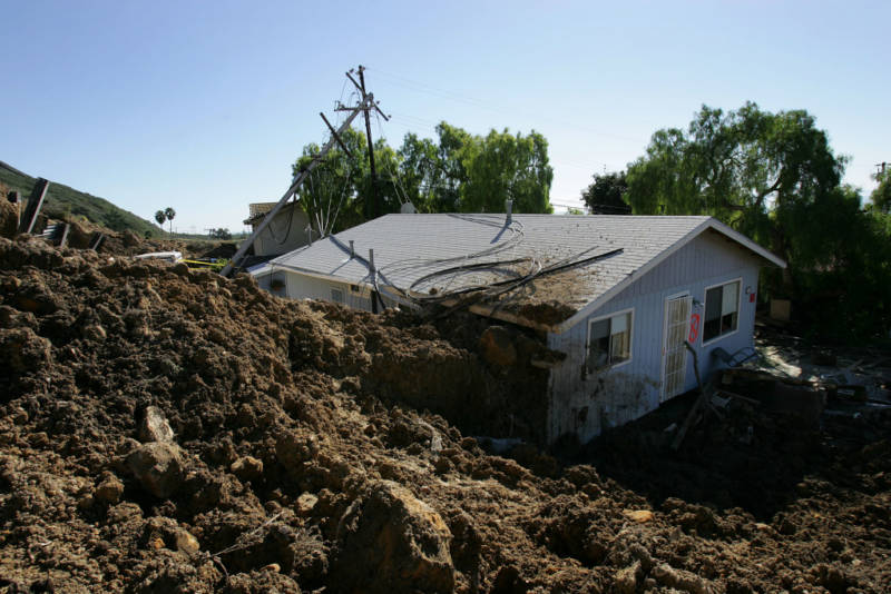 A home damaged in the deadly mudslide that killed at least 10 people is one of those that residents will not be allowed to enter on the first day that evacuated residents are allowed to return to their devastated community January 14, 2005 in La Conchita, California. With at least three people still missing, rescuers suspended search efforts after the hillside above shifted, raising concern that another mudslide could occur. 15 homes were destroyed and 16 damaged when the mudslide poured over part of the small seaside town of 260 people at the end of the area's heaviest rainfall in a 15-day period since records began in 1921.