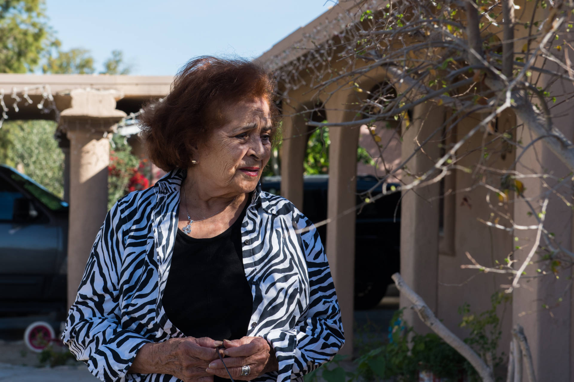 Ramona Morales, 79, had to pay about $6,000 in legal bills on top of a fine because one of her tenants kept chickens in the backyard of a rental house. Some Southern California cities are prosecuting code violators and slapping homeowners with gigantic legal bills they can't afford to pay. Jessica Chou for NPR