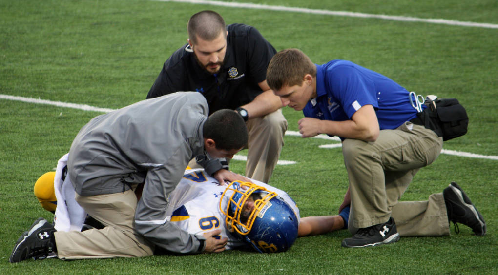 A high school football player in Illinois gets medical attention after an injury on the field.