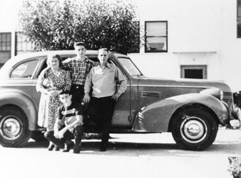 The Bronzini family: Clara, Al, Guido, and Lorenzo (in front), pose with their new 1939 Pontiac.