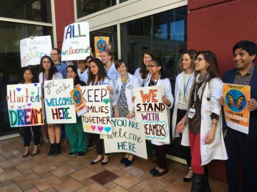 Doctors at UCSF Benioff Children's Hospital in Oakland rally for immigration legislation to protect their undocumented patients.