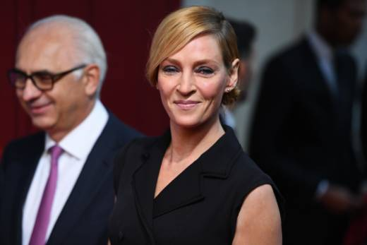 Actress Uma Thurman (R) at an event in Paris on November 3, 2016. Thurman has accused Harvey Weinstein of forcing himself upon her sexually and director Quentin Tarantino of making her perform a dangerous car stunt that injured her.