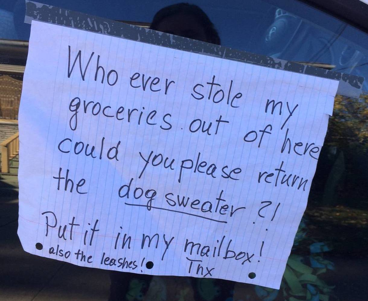 A car parked in the Temescal Neighborhood of Oakland, Calif. with a sign asking for a car thief to return a sweater.