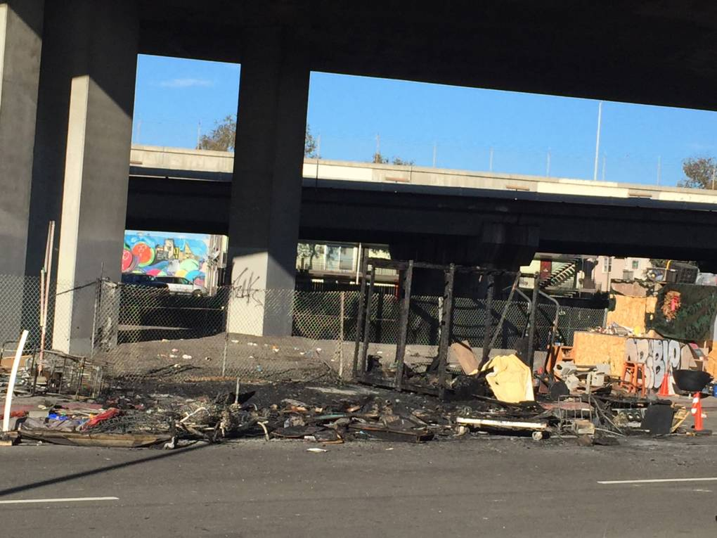 A man died in a fire at a homeless encampment near Highway 24 and I-980 on Feb. 12, 2018 in Oakland.