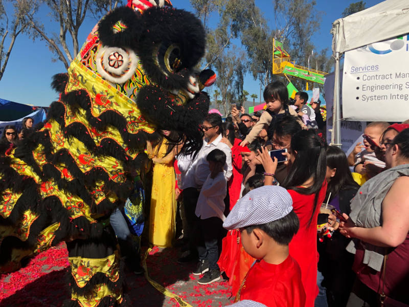 The lion dance and dragon dances was one of the highlights of the event, with multiple performers in each costume coordinating to move around the crowd.