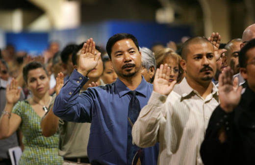 Immigrants are sworn in as U.S. citizens during a naturalization ceremony in Pomona, California.