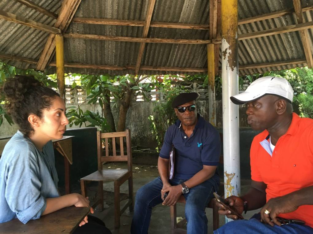 Reconciliation Commissioner John T. Stewart, and Hassan Bility at the Lutheran Church Palava Hut.