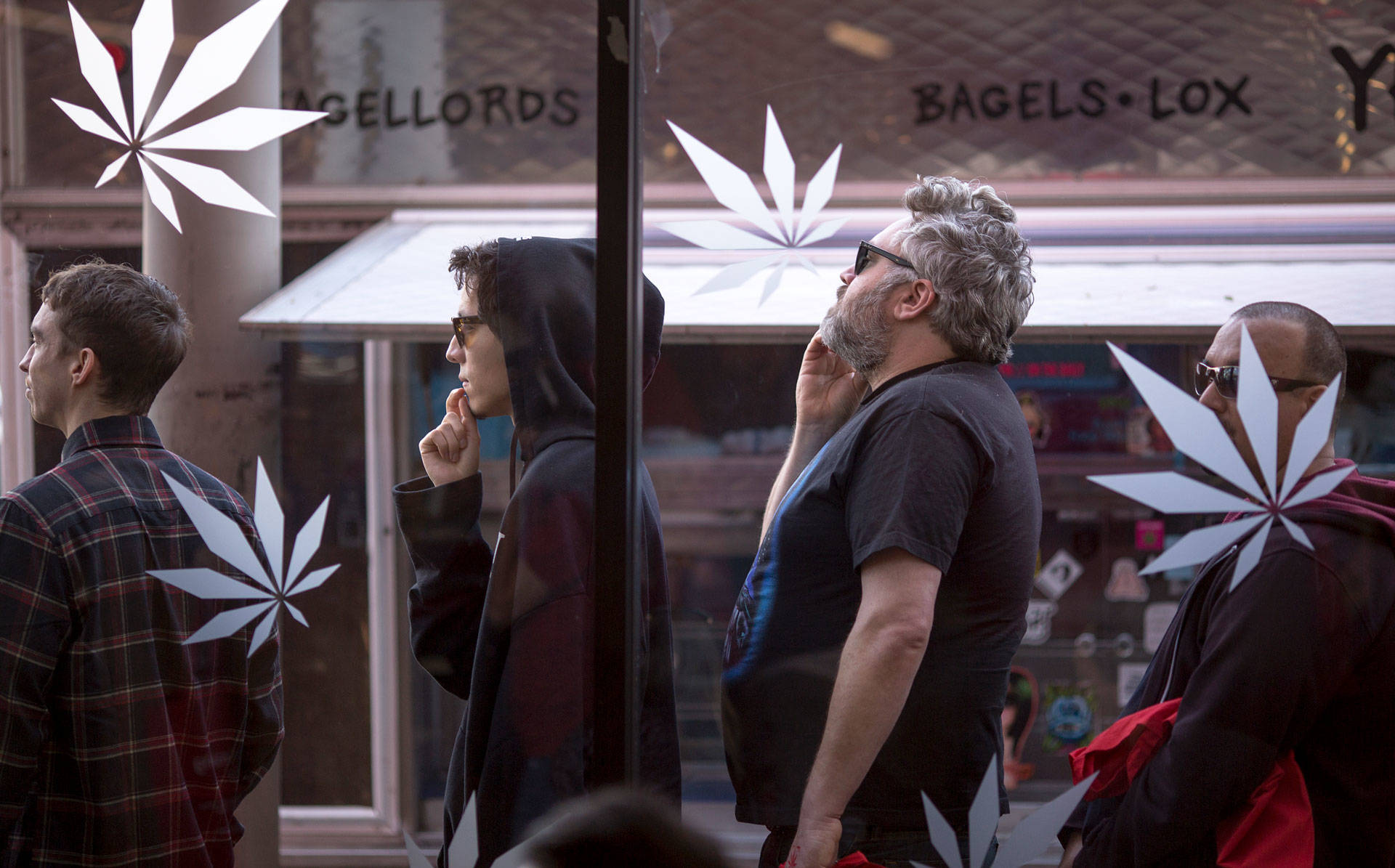 People stand in line to get into one of the two Los Angeles area pot shops that began selling marijuana for recreational use on January 2, 2018.