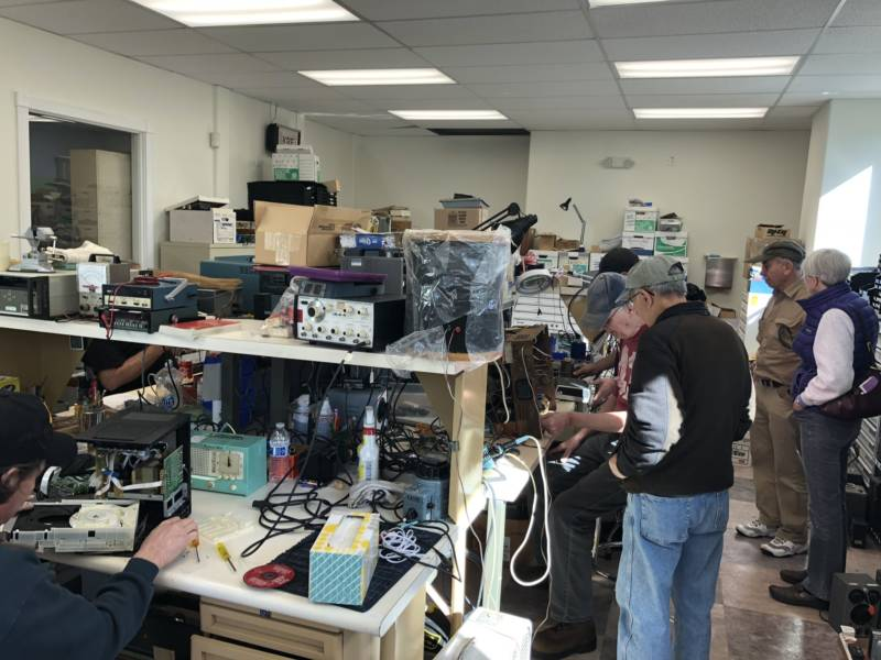 Members of the California Historical Radio Society tinker with old AM/FM radios at the society's building in Alameda on February 3, 2018.