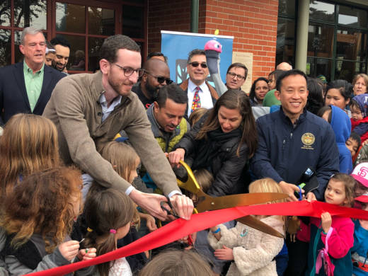 State Sen. Scott Wiener cuts the ceremonial ribbon along with many kids at the reopening of the Randall Museum in San Francisco on Sunday, Feb. 11, 2018.
