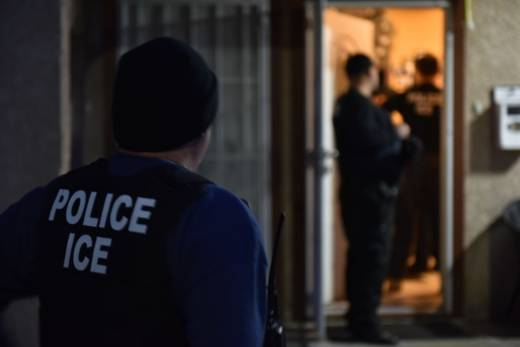 Immigration and Customs Enforcement officers carry out a raid in Los Angeles on Feb. 11, 2018.