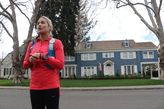 Tour guide Jenn Kistler-McCoy, founder of Sac Running Tours, showcases the iconic blue house to her walking tour.
