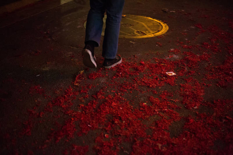 Firecracker debris litters the ground of Chinatown after a successful Lunar New Year celebration in San Francisco.
