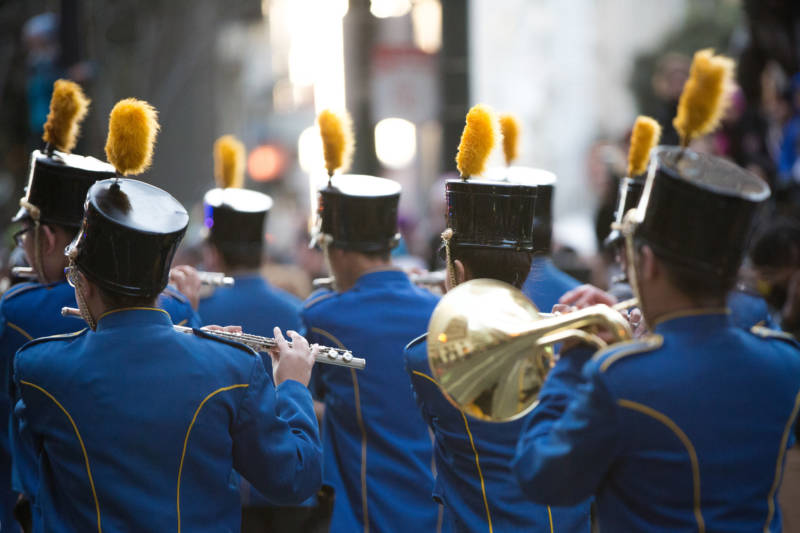 The bass drums of marching bands boomed down Market at the height of the Lunar New Year Parade in San Francisco, revving up the the crowd despite cold temperatures.