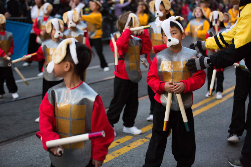 Students from the Tat Wong Kung Fu Academy show off their best moves to the crowd while marching in the Lunar New Year Parade in San Francisco.