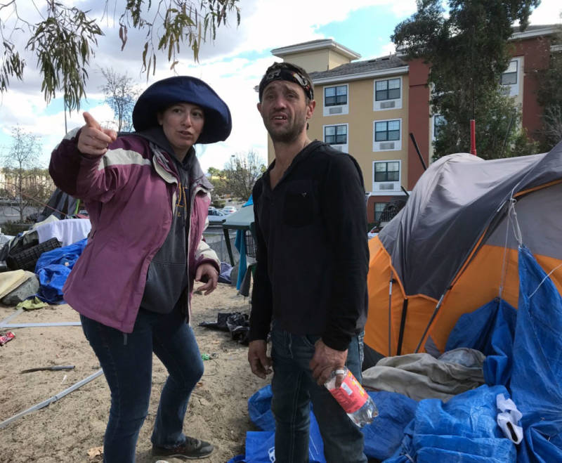Brooke Weitzman, a lawyer for the homeless, urges riverbed resident Scott Henderson to pack up so he can go spend the night at a motel.