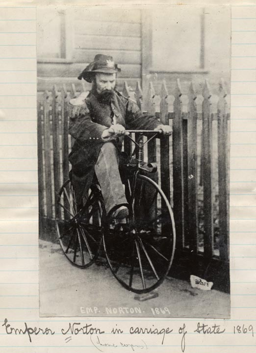 A snarky caption is scrawled below this image of Norton on a bicycle.