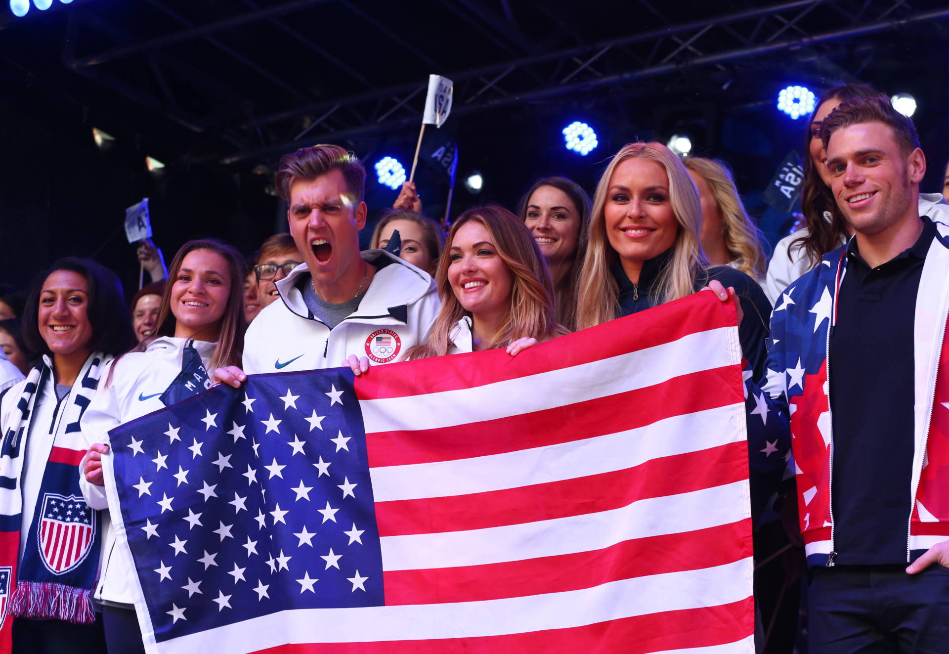 Bobsledder Elana Meyers Taylor, snowboarder Alex Deibold, skier Lindsey Vonn, skier Gus Kenworthy and members of Team USA pose for a photo during the 100 Days Out 2018 Pyeongchang Winter Olympics Celebration. Mike Stobe/Getty Images for USOC