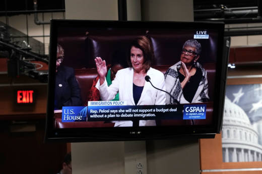 A TV in the Capitol shows House Minority Leader Nancy Pelosi, D-Calif., giving a speech on the House floor Wednesday. Pelosi spoke for more than eight hours as a protest because negotiations over the future of the expiring Deferred Action for Childhood Arrivals program have stalled.
