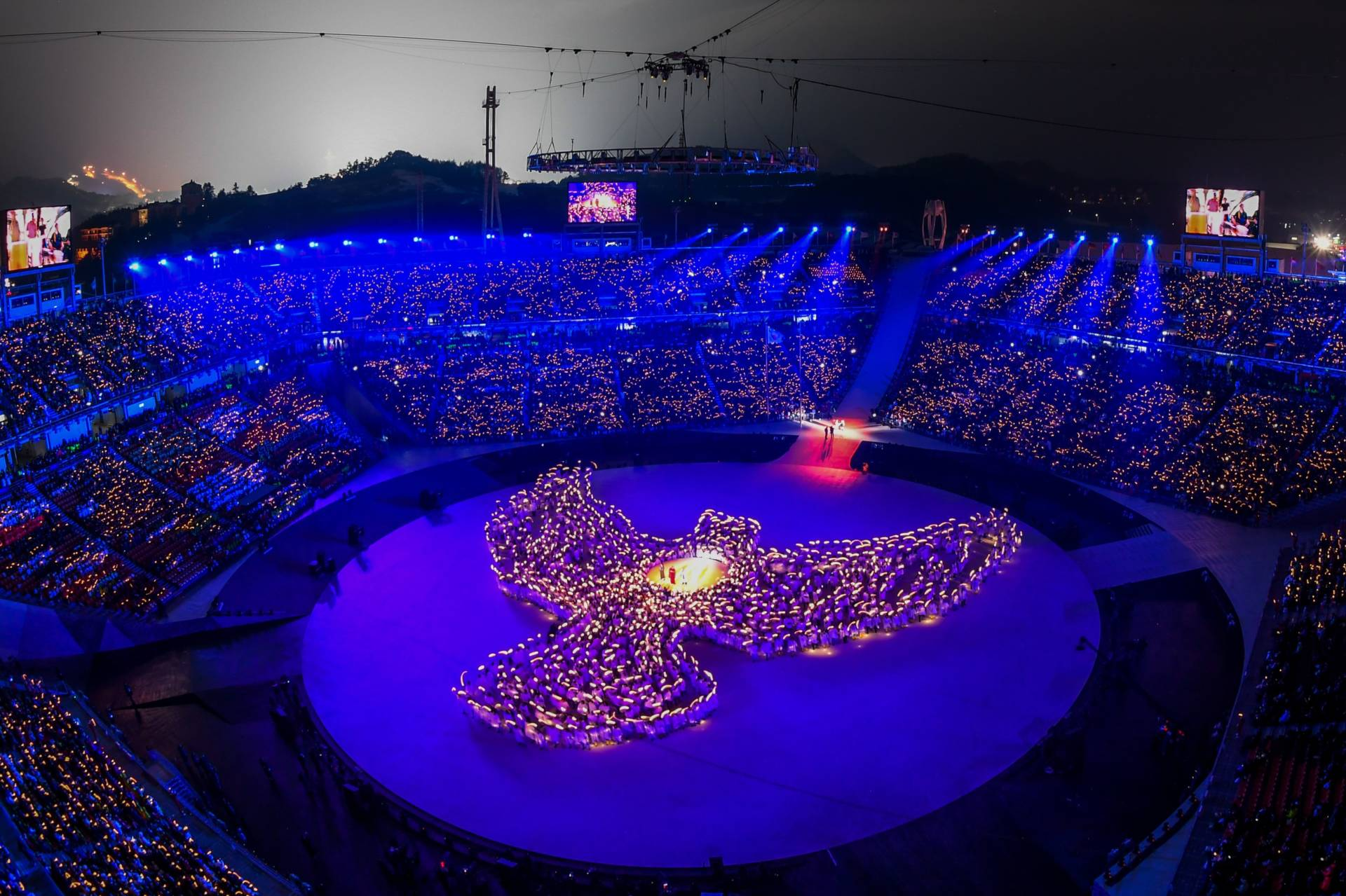 More than 1,200 people, including 1,000 residents of Gangwon province, form the shape of a dove out of candlelight during the opening ceremony. Francois-Xavier Marit/AFP/Getty Images