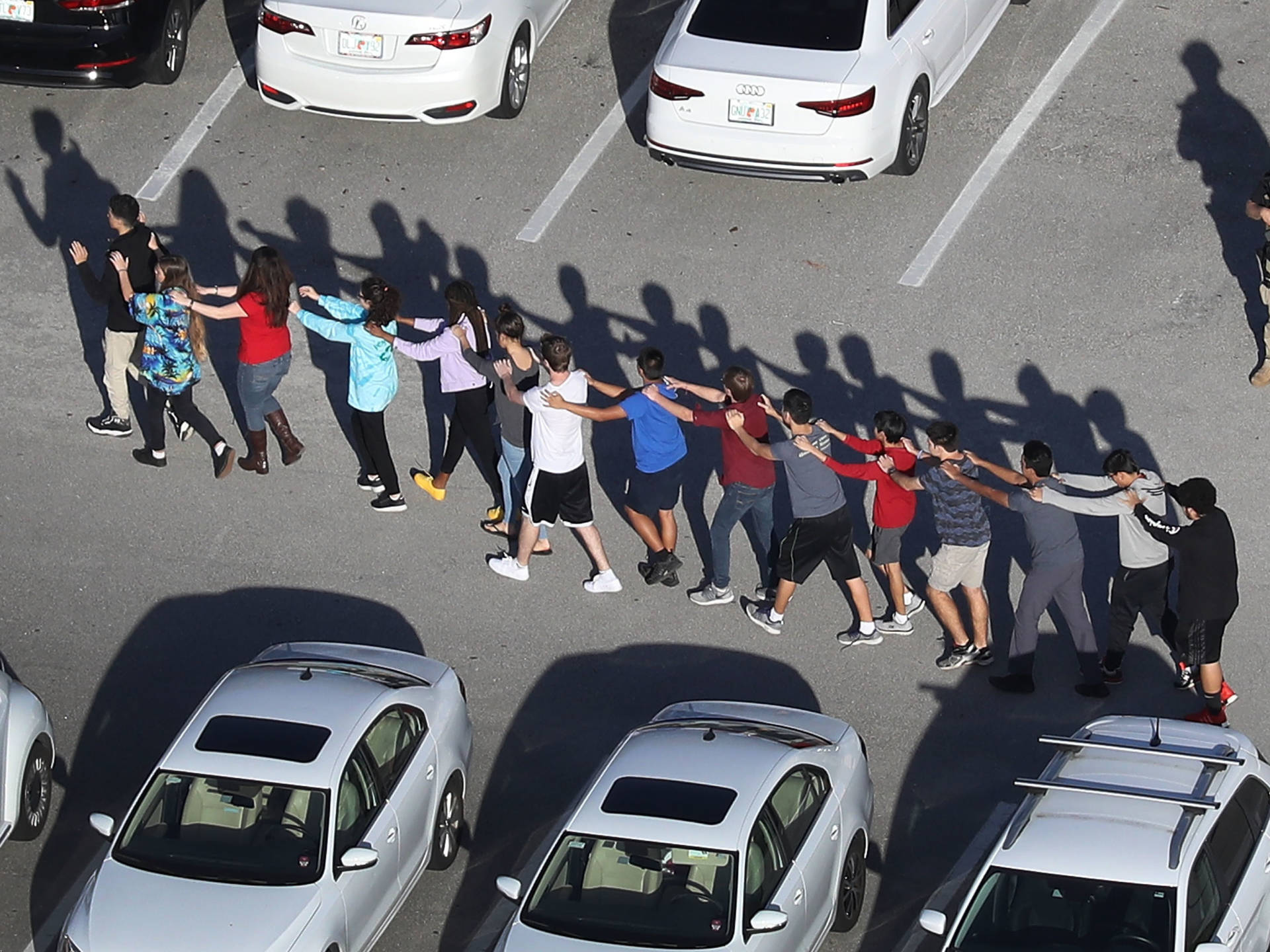 People are brought out of the Marjory Stoneman Douglas High School after a shooting at the school that killed at least 17 people on Wednesday in Parkland, Florida. Joe Raedle/Getty Images