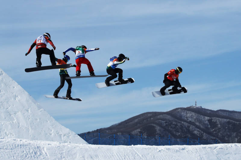 Men compete during the snowboard cross quarterfinals on Thursday.