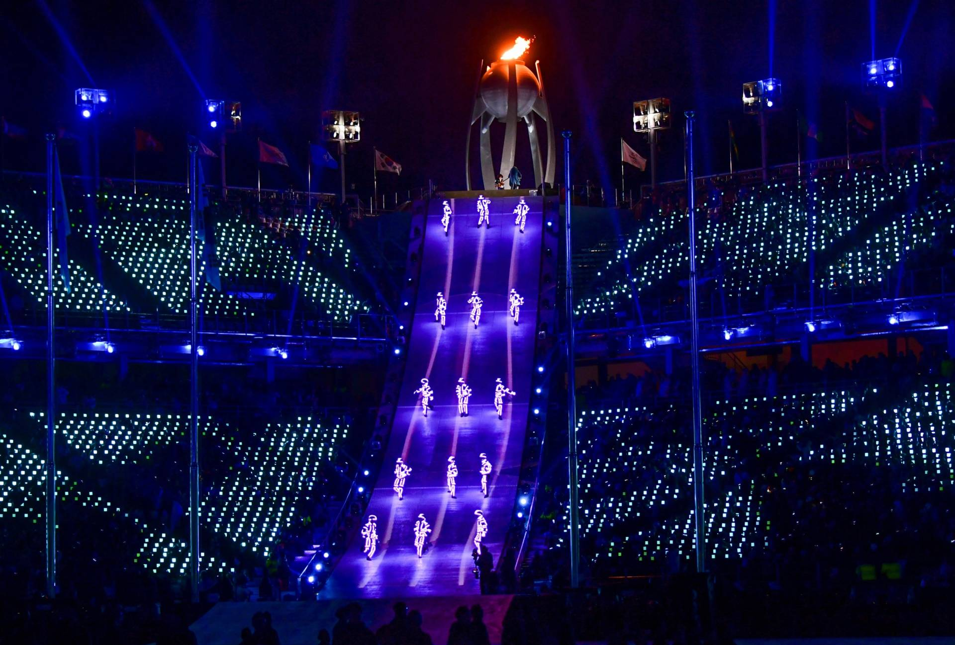 """Artists perform near the Olympic flame during the closing ceremony. """"Although parting is sad, we will remember Pyeongchang with beautiful memories,"""" said Lee Hee-beom, the Pyeongchang Olympics organizing committee president.  Martin Bernetti/AFP/Getty Images"""