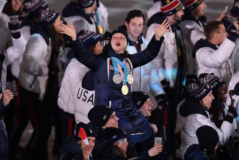 Four-time Olympian Arianna Fontana of Italy, celebrating in the Parade of Athletes, won gold, silver and bronze in Pyeongchang.