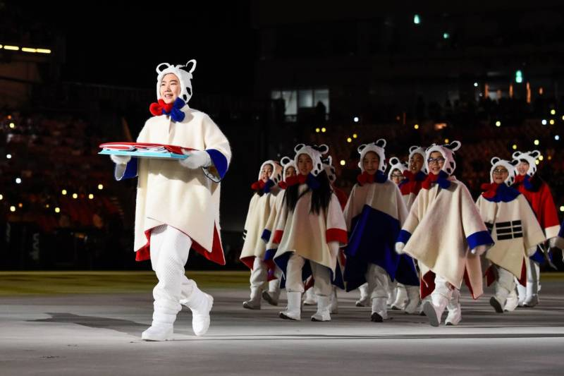 Performers deliver a South Korean flag.