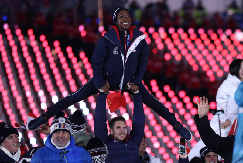 Figure skaters Vanessa James and Morgan Cipres of France march in the Parade of Athletes.