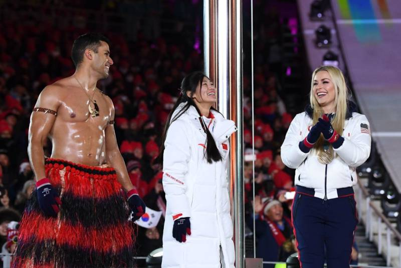 Tongan cross country skier Pita Taufatofua (left) once again marched bare-chested in frigid temperatures, and met onstage with China's silver medalist snowboarder Liu Jiayu and U.S. gold medalist Lindsey Vonn.