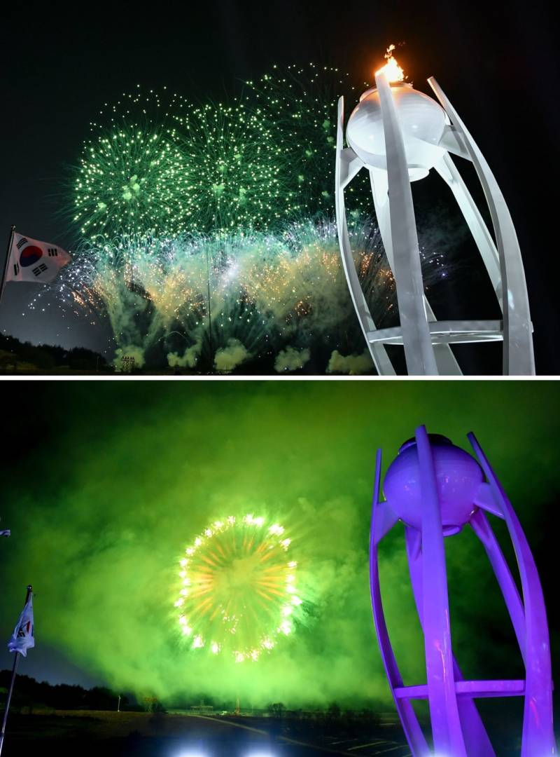 The Olympic flame is extinguished amid fireworks.