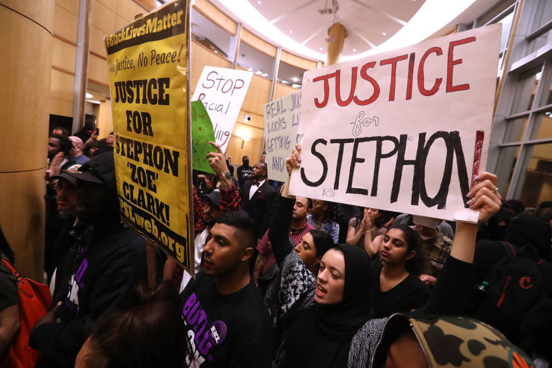 Protesters fill the lobby outside of the Sacramento City Council chambers to protest the police shooting death of Stephon Clark.