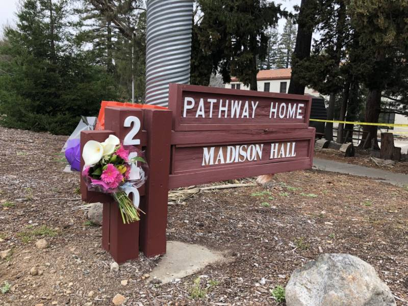 Flowers left Yountville Veterans Home in memory of the three victims of Friday's shooting.