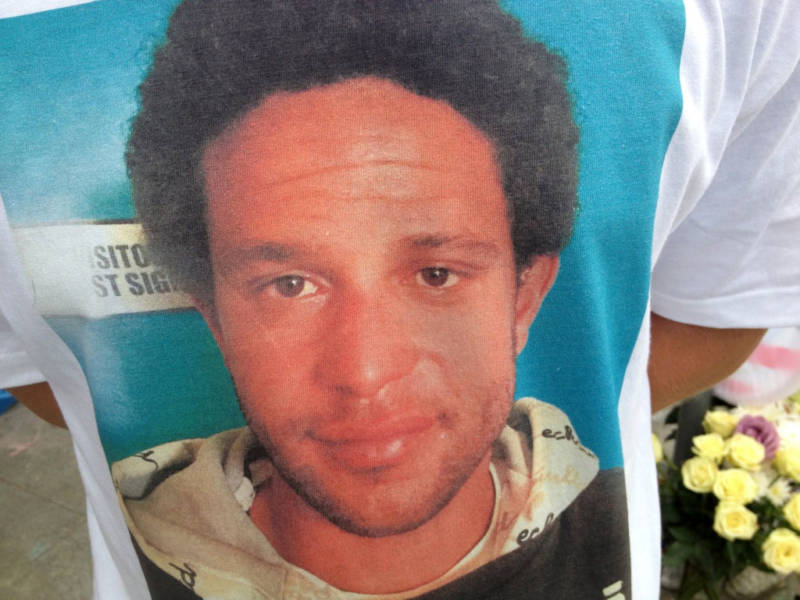 A friend of Brendon Glenn wears a t-shirt with his photo. Glenn was fatally shot by LAPD officers May 5, 2015.