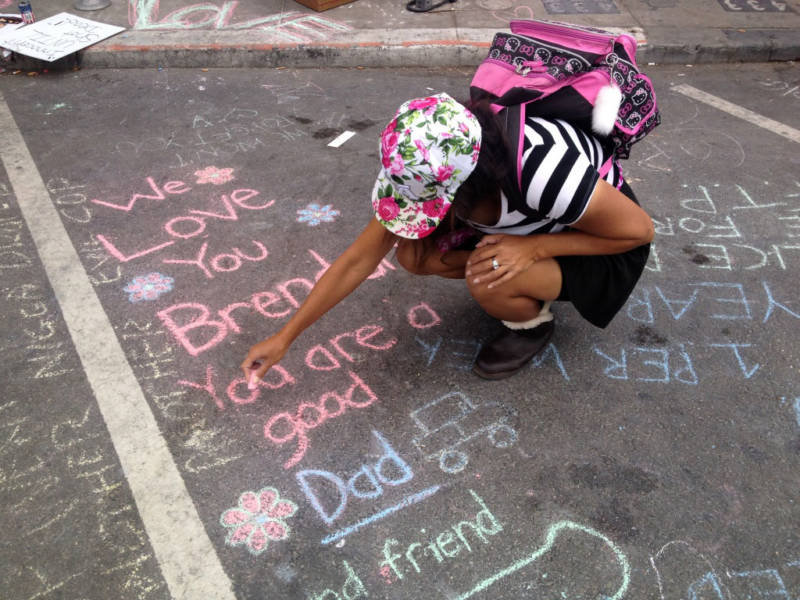 Friends of Brendon Glenn wrote in chalk on the pavement where he died after being fatally shot by an LAPD officer May 5, 2015.