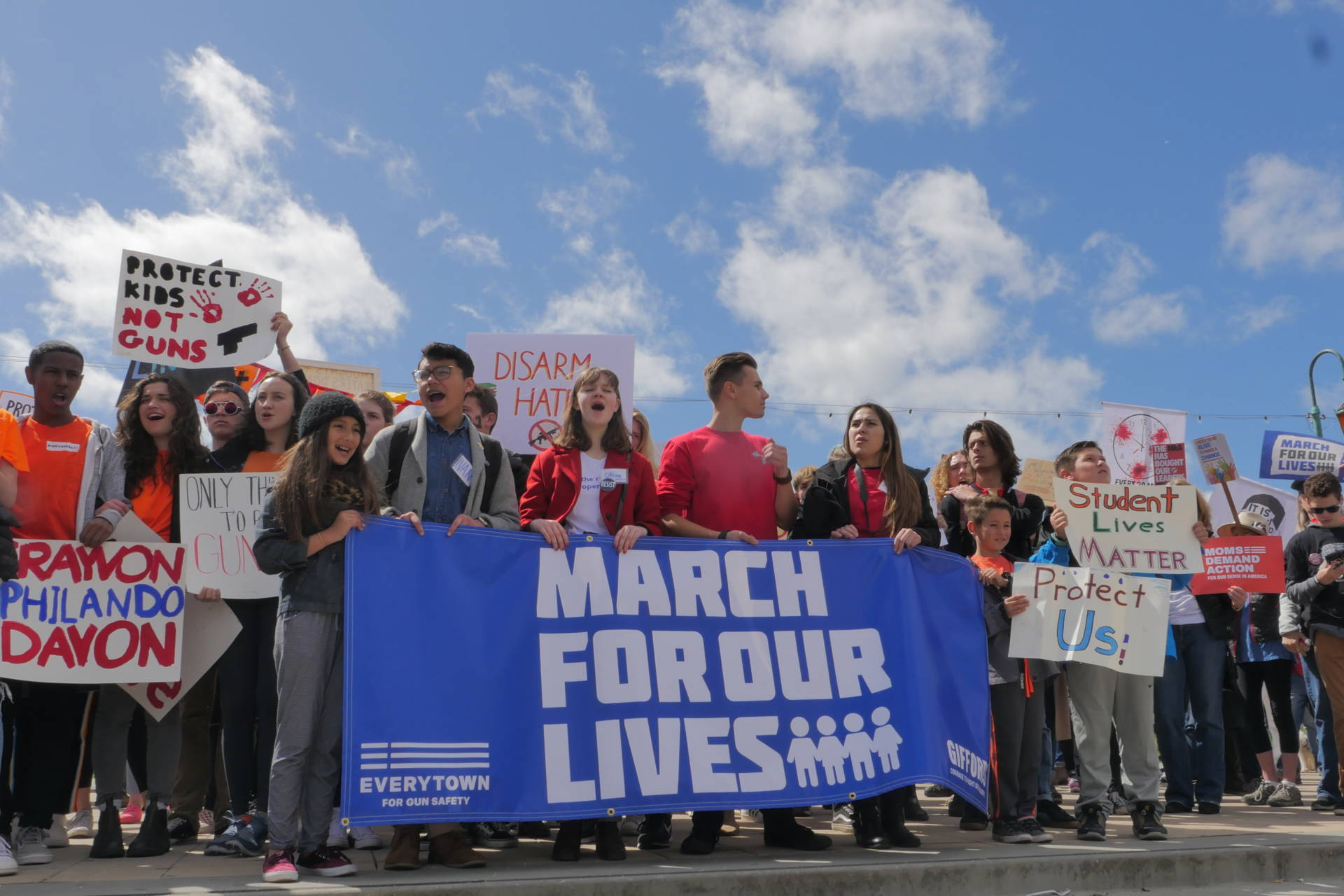 Student organizers march at Lake Merritt as similar marches were happening around the world.  Sheraz Sadiq/KQED