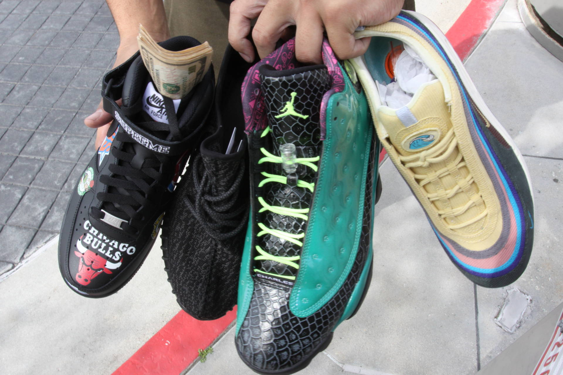 Attendees began to hawk shoes like these four sneakers while they were waiting in line for the doors to open at Sneaker Con on Saturday, March 31, 2018.