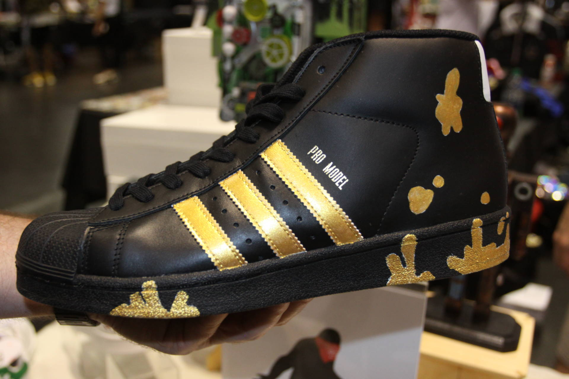 Local artist Rasterstache used 24-karat gold paint to create this pair of Adidas, which is priced at $650.