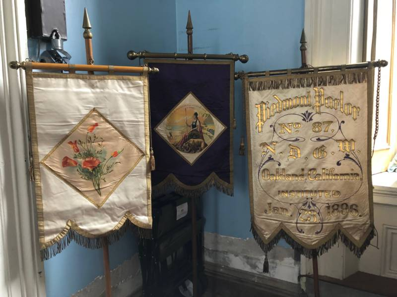 Banners from the Daughters of the Golden West were on display. The two banners on the left are at least 100 years old and adored with poppies and Minerva, to represent California. They are used in ritualistic initiation ceremonies. The banner on the right represents the Piedmont chapter of the organization.