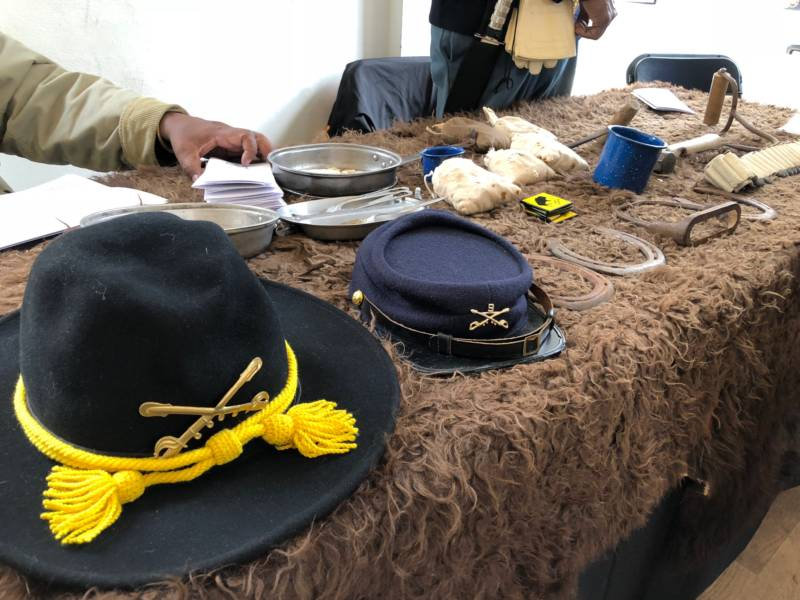 The Buffalo Soldier table had historical items for people to interact with. The hats, mess kit, rations and bale hooks would have all been used by the soldiers.
