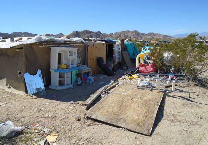 This handout photograph obtained March 1, 2018 courtesy of the San Bernardino County Sheriff's Department, Morongo Basin Station, shows the area in Joshua Tree where a couple were allegedly living with their three children inside a box for four years.