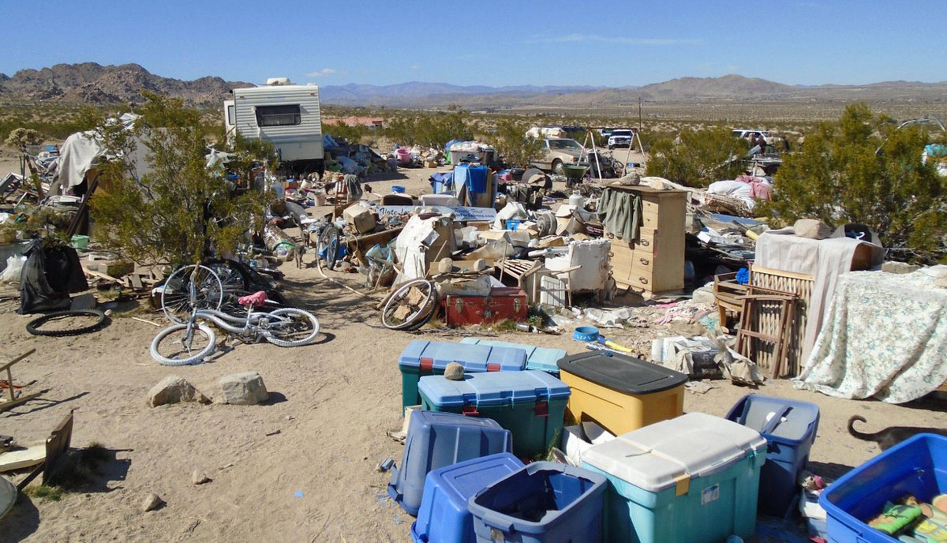 This handout photograph obtained March 1, 2018 courtesy of the San Bernardino County Sheriff's Department, Morongo Basin Station, shows the area in Joshua Tree where a couple were allegedly living with their three children inside a box for four years. STR/AFP/Getty Images