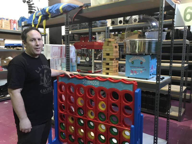 "Joe Fernandez stands next to a giant Connect Four set in his company's downtown Los Angeles warehouse. The Joymode co-founder says, among his customers, ""Pretty much anything you can get giant versions of is really popular."" Feb. 5, 2018."