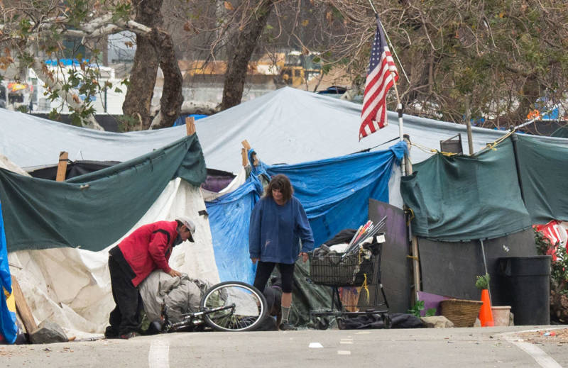 A homeless encampment made of tents and tarps lines the Santa Ana riverbed near Angel Stadium in Anaheim on Jan. 25, 2018.