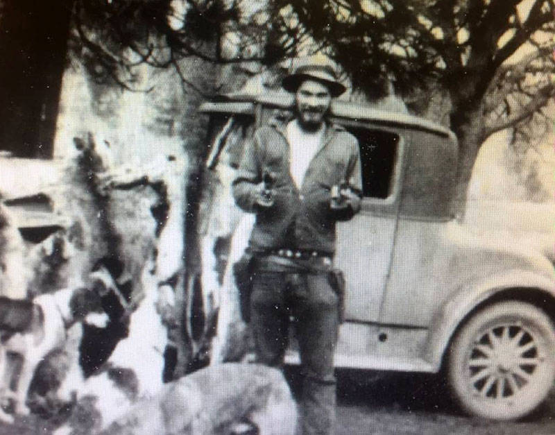 George Patton at Peanut, with coyote pelts and a pair of six-shooters, circa 1940.