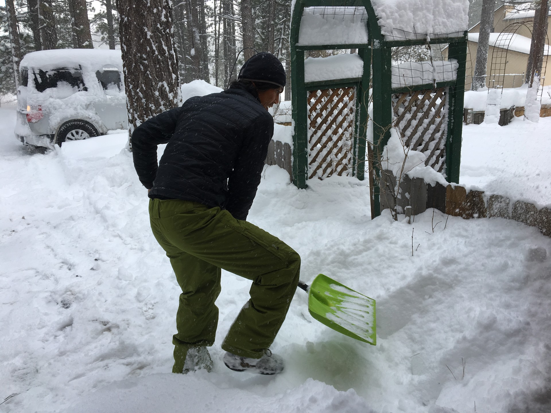 Jin Joo shovels his driveway near Lake Tahoe after a blizzard dumped 3 feet (1 meter) of snow in the Sierra Nevadas.